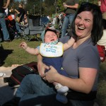 Mama tortures E with adorable baby bonnet at the Cabbagetown Chomp & Stomp